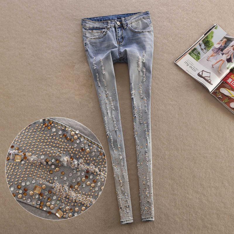 1a0ba7cef 2019 nueva moda Primavera estilo Jeans Mujer Casual cráneo denim Pantalones  rasgados cuentas elásticas señoras skinny lápiz pantalones Z324
