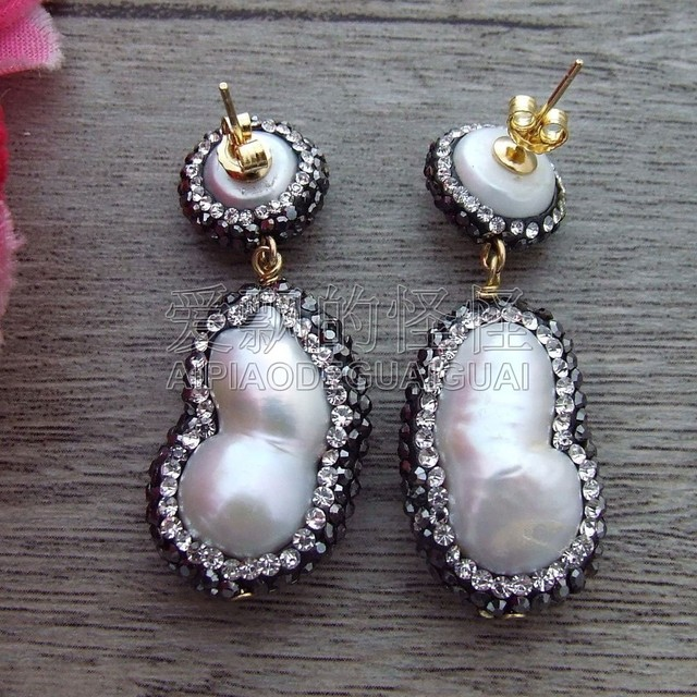 E100714 White Twins Pearl Trimmed With Marcasite Earrings