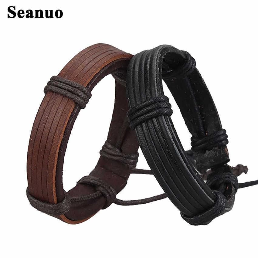 Seanuo ユニセックス 100% 本革カフバングル男性ファッションパンクロック手織り女性チャームリストバンドラップブレスレット