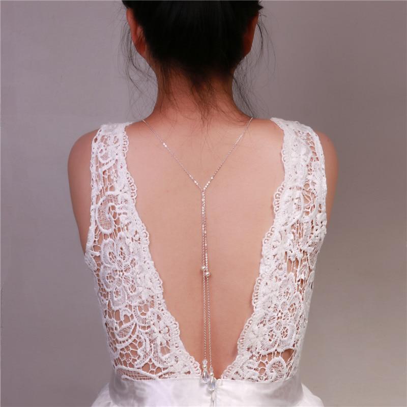 achtergrond ketting water dorp glas kristal hanger parel rug ketting diepe V bruid bruiloft sieraden backless jurk lange ketting