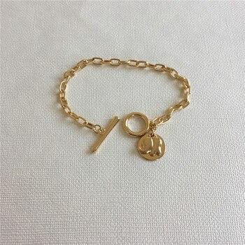 Bonita pulsera de niña, elefante chapado de COLOR dorado en el disco redondo, pulsera de barra en T