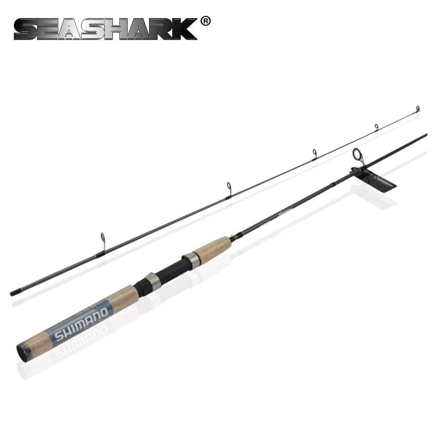 ФОТО SEASHARK Top Quality Fishing Rod Spinning Fish Hand Fishing Tackle Lure Rod  M power ultralight 2.1m2.4m Portable 99% carbon