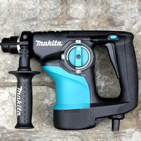 Makita HR2810 Heavy hammer impact drill 3 function modes: Single + hammering+ hammering 800W 4,500ipm 1,100rpm Concrete Openings