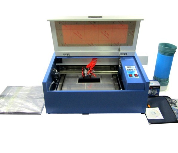 Offres spéciales Mini CO2 Laser Tube modèle Machine de découpe/bambou/cuir/caoutchouc Laser graveur