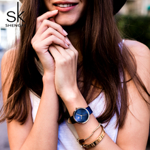 цены на Shengke 2018 New Blue Leather Strap Women Watches Simple Dial Ladies Quartz Watch Female Clock Relogio Feminino Bayan Kol Saati  в интернет-магазинах