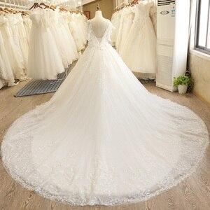 Image 2 - SL 7805 осень Пышный рукав с открытой спиной кружевной аппликацией Иллюзия лиф v образным вырезом Свадебное платье 2017