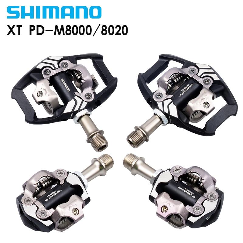 цена Shimano 2016 NEUE XT PD M8000 M8020 Self-Locking SPD Pedale MTB Komponenten Mit fur Fahrrad Racing Mountainbike teile онлайн в 2017 году
