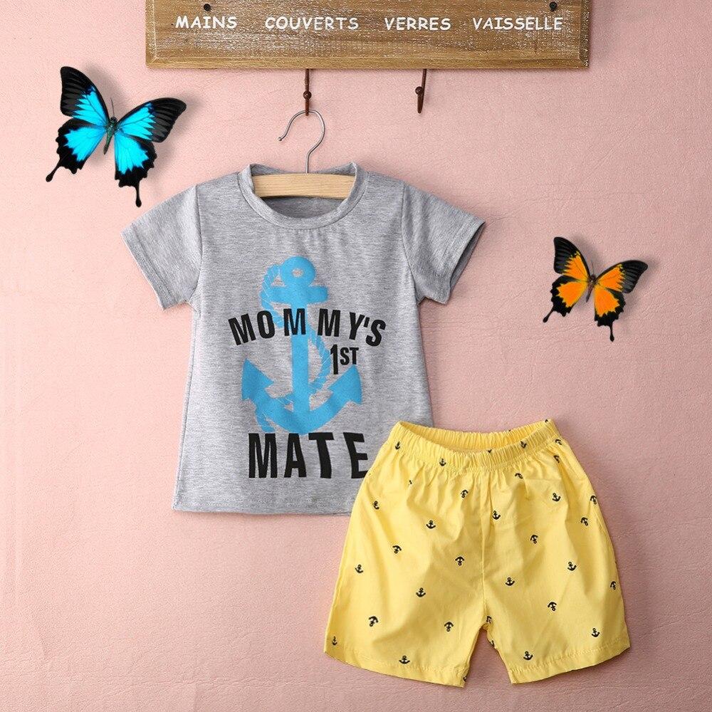 Милые Новинка 2017 детские для маленьких мальчиков cptton 2 шт. якорь наряды короткий рукав буквы комплект со штанами и футболкой