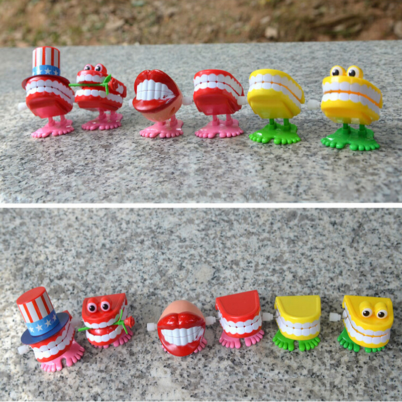 Spring Wind Up Jump Tooth Dental Gift Dental Toys Wholesale Spring Plastic Toys Jump Teeth Chain For Children Cute Toys For Kids