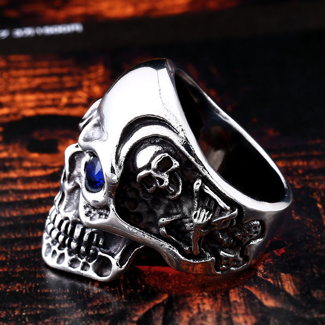 STAINLESS STEEL SKUL RING WITH RED BLUE EYE