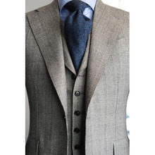 Tailored grey checker pattern suit