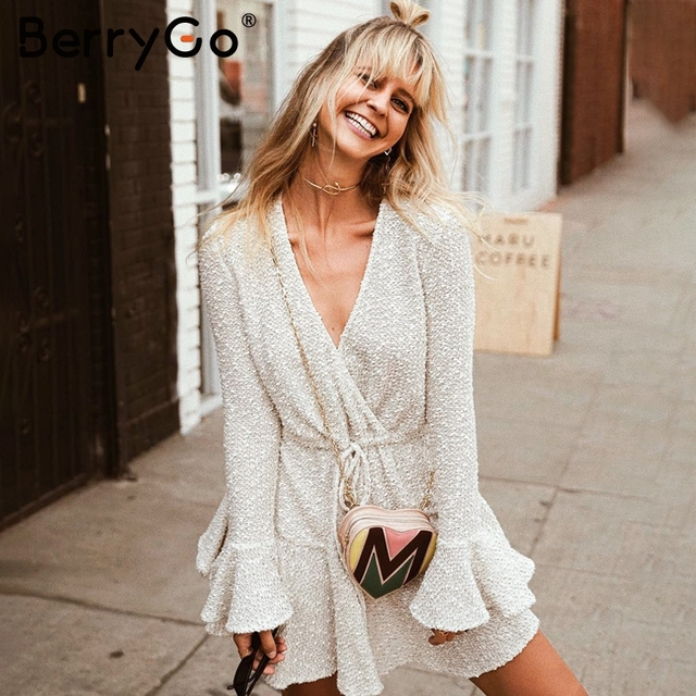 663d66c638a BerryGo V neck ruffle winter dress women 2018 Flare sleeve sash autumn  dress short Loose high