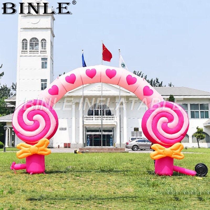 Arc gonflable rose d'arc gonflable extérieur adapté aux besoins du client de sucette pour la promotion d'événement