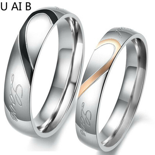 Mixed batch of new fashion jewelry heart-shaped puzzle titanium steel couple ring wholesale ring