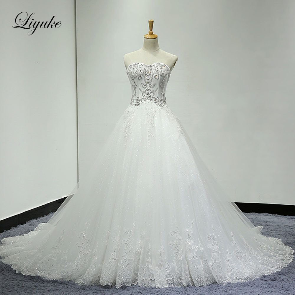 Liyuke Strapless A Line Wedding Dress With Stones Lace Up Back Closure Sequin Lace Of Bridal Dress
