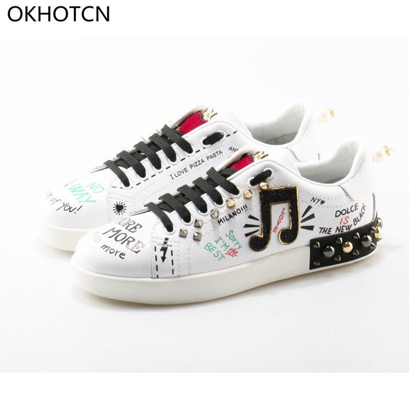 OKHOTCN Fashion Rivets Heel Laced-up Bling Women Flats Pearl Decor Women  Music Graffiti Cross-tied Shallow Female Leisure Shoes 983f233b1a48