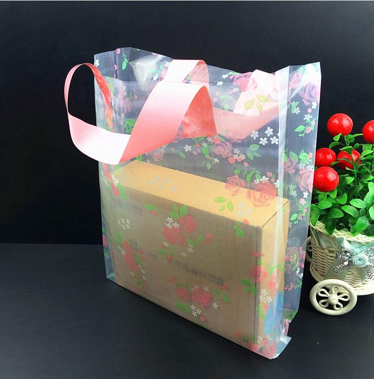 Alice, Wholesale 50pcs/lot White/Pink Flower Plastic Bag Shopping Jewelry Packaging Plastic Gift Bag With Handle