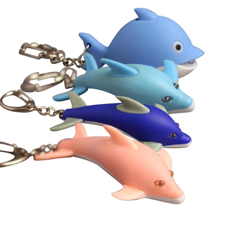 2018 New 1Pcs Mini Dolphin Cartoon toy Action Figure LED light+Sound KeyChain Holder