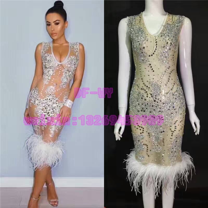 Aliexpress.com   Buy Female DJ sexy perspective skin colour rhinestone  ostrich feather sleeveless dress skirt suit bars nightclubs holiday party  stag from ... 5a3e6f14934c