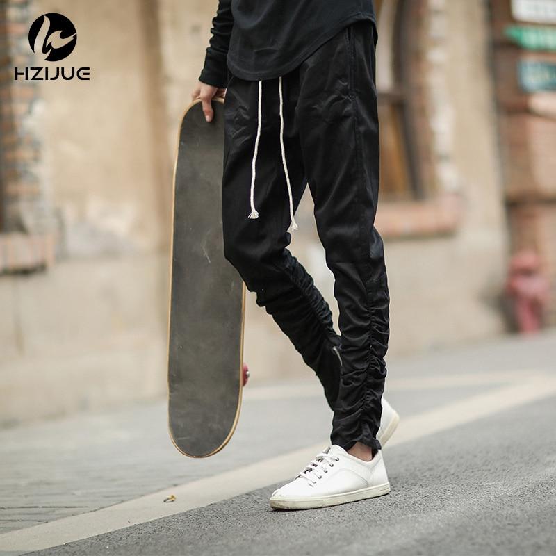 HZIJUE 2018 Új érkezési férfiak Nadrág Gumi elasztikus nadrág lábak cipzáras alkalmi nadrág Felszerelés Beam lábtartó nadrág