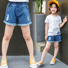 Girls jean hot pants summer thin Korean edition solid color childrens wear new cuhk worn-out denim shorts