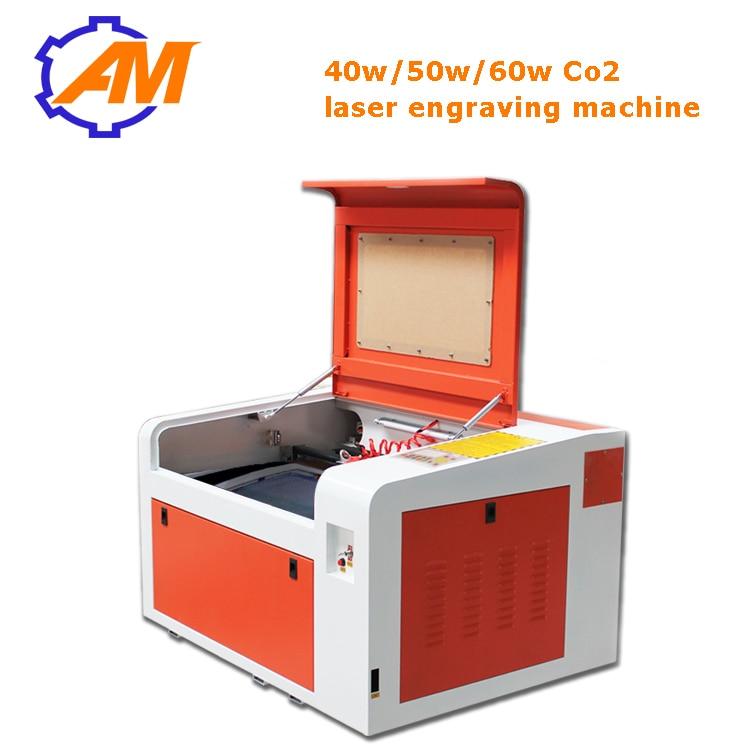 Plačiai naudojamas 600 * 400 mm darbinio ploto CO2 lazerinis - Medienos apdirbimo įranga - Nuotrauka 1