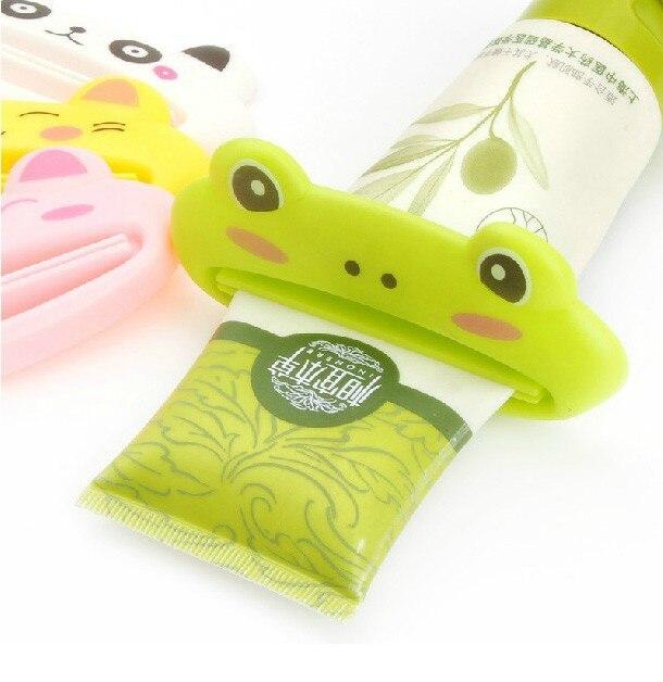 Quente casa de banho tubo rolamento squeezer fácil dos desenhos animados creme dental dispensador cosméticos limpador facial espremedor super prático