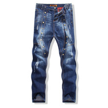 Europe and the United States men s wear jeans crotch nail rivet jeans pants slim personality
