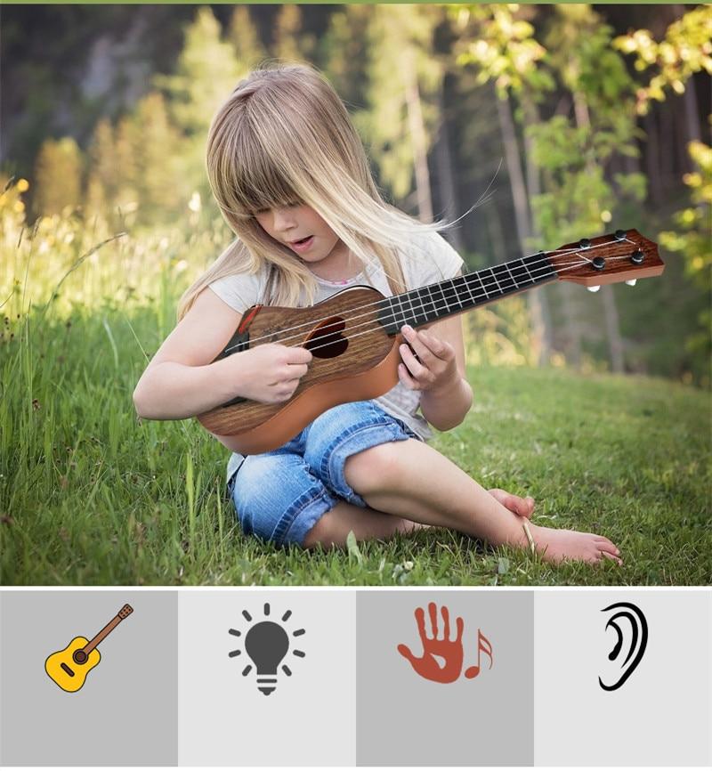 New 39 44cm Kids Mini Ukulele Kids Guitar Musical Instruments Toys for Children Music Education Beginner X 39 mas Gift in Toy Musical Instrument from Toys amp Hobbies