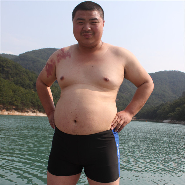 f056bd828c 2015 new men's boxer swimsuit fashion hot springs swimming trunks  fertilizer to increase the fat you J408