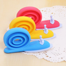 Cute Soft EVA Plastic Baby Home Safety Door Stopper Protector Children Safe Snail Shape Door Stops Baby gate corner protector(China)