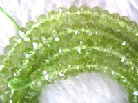 Xiuli 000424 Peridot AAA Roundel Faceted 4 2mm Beads 15 Nature