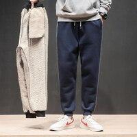 冬プラスベルベットパッド入りスウェットパンツパンツ男性ファッション動きコロケーション大サイズ足ハーレムパンツ潮