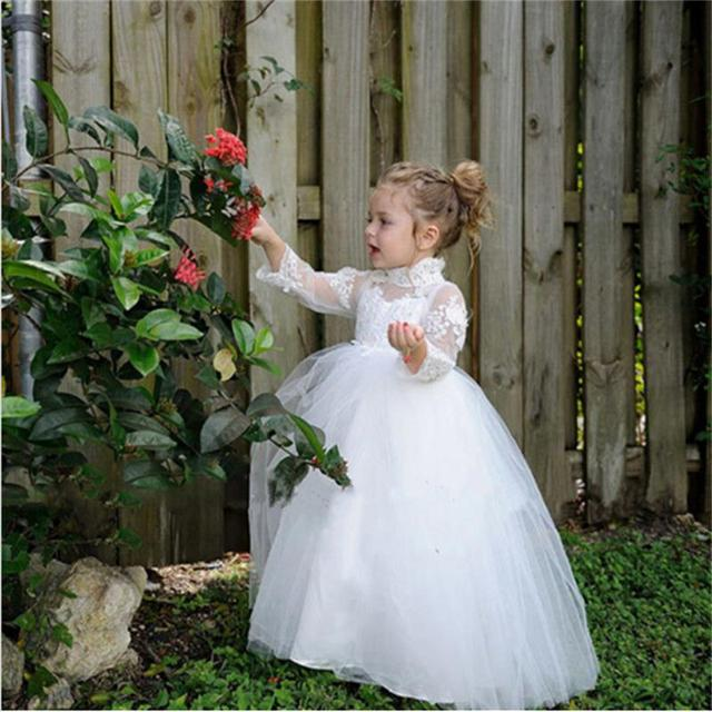2016 Princess Flower Girls Dress Long Sleeve White Appliques Ball Gown Cute Girls  First Communion kids bcafe03b1e2d
