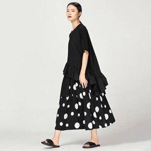Image 2 - CHICEVER verano Casual Dot Print mujeres falda elástica alta cintura bolsillos suelta tamaño grande media pantorrilla faldas plisadas 2019 moda nuevo