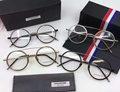 2017 nueva moda asistente thom titanium marcos de las lentes hombres mujeres ronda de la vendimia gafas de grau anteojos con la caja original