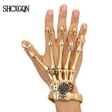 4e5328a2ef9 Pulseras Punk de oro de moda brazaletes para Mujer Accesorios calavera  esqueleto mano elástica Steampunk pulsera brazalete hombr.