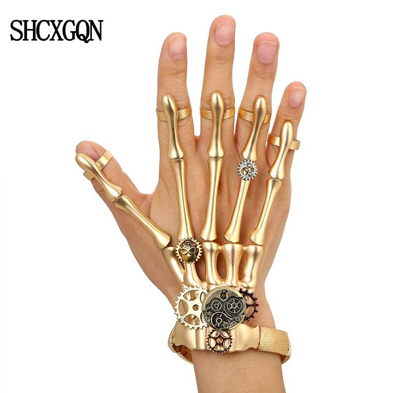 c5a3fee55da1 Pulseras Punk de oro de moda brazaletes para Mujer Accesorios calavera  esqueleto mano elástica Steampunk pulsera brazalete hombres joyería regalo