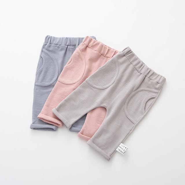 2017 del resorte del bebé nuevo, los niños y las niñas, externa bolsillo grande de algodón leggings, pantalones caseros