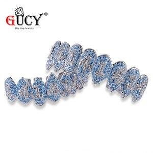 Image 4 - GUCY ледяной хип хоп 1414 зубы Grillz Bling AAA кубический циркон серебряный цвет восемь топ и низ вампир грили набор для подарка