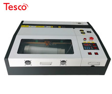 цена на 50W CO2 4040 laser engraving and cutting machine with up and down honeycomb working table