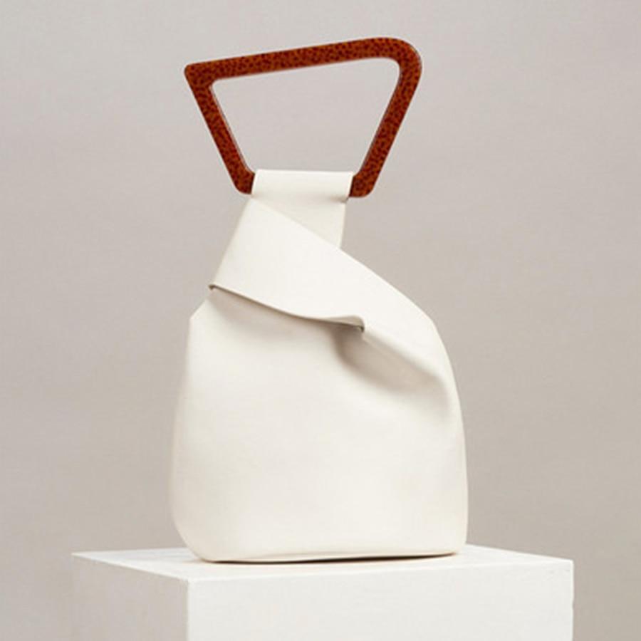 Bolsos de mano de acrílico personalizados para mujer bolsos de mano de cuero sólido de alta calidad para mujer nuevos bolsos de cubo irregulares de verano