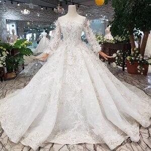 Image 1 - Bgw HT4304 特別ウェディングドレスと羽のためのシースルーバック手作りボタンブライダルドレス vestido デ noiva プリンセサ