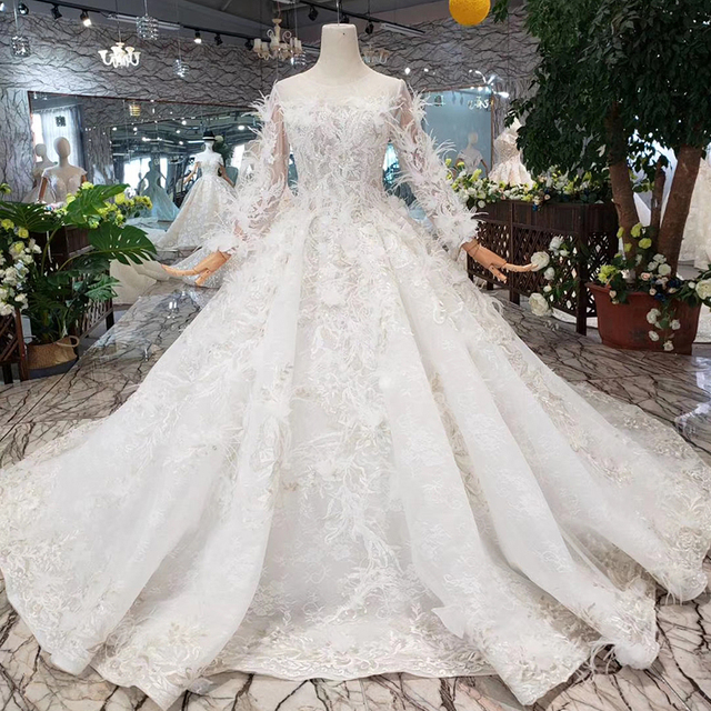 Bgw HT4304 特別ウェディングドレスと羽のためのシースルーバック手作りボタンブライダルドレス vestido デ noiva プリンセサ