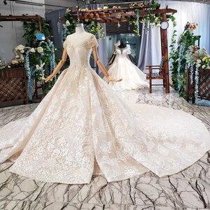 Image 3 - HTL670 ווסטרן תחרה חתונה שמלות אשליה o צוואר קצר שרוולים מחוך טול חתונת שמלת קריסטל חרוז robe דה mariee בוהם