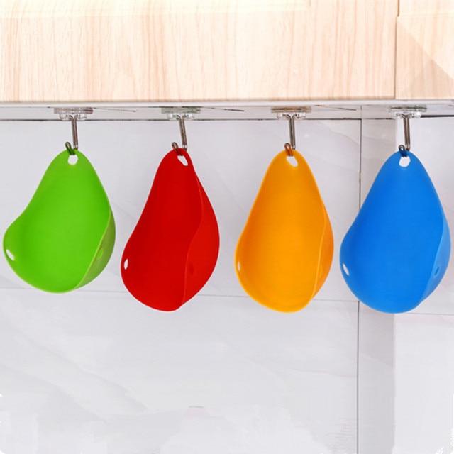 Pocheuse à oeufs en silicone bleu, jaune, rouge et vert