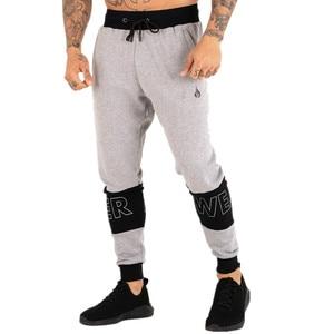 Image 4 - Pantalon de sport pour homme, pantalon de Fitness pour jogging, en coton extensible, vêtement Slim pour entraînement, automne, décontracté