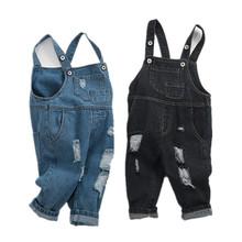Kombinezon dresowy dla dzieci 12M do 4T kombinezon dla dzieci spodnie jeansowe niebieski czarny z dziurami chłopcy dziewczęta odzież dziecięca tanie tanio CN (pochodzenie) COTTON Unisex Przycisk fly Stałe Proste Kombinezony 310527 Pasuje prawda na wymiar weź swój normalny rozmiar