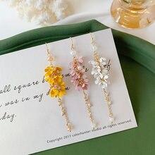 Novo coreano balançar brincos de gota longo rosa amarelo feminino atacado doce flor borla pendurado moda jóias férias