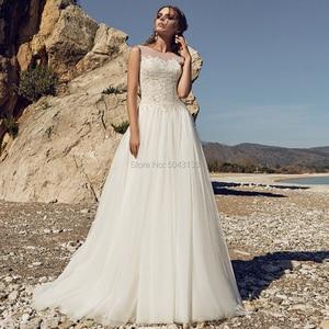 Image 1 - Robe de Mariee Bohemian Wedding Dresses Sexy Sheer Neckline Sleeveless Open Back Lace Wedding Bride Gowns Floor Length 2020